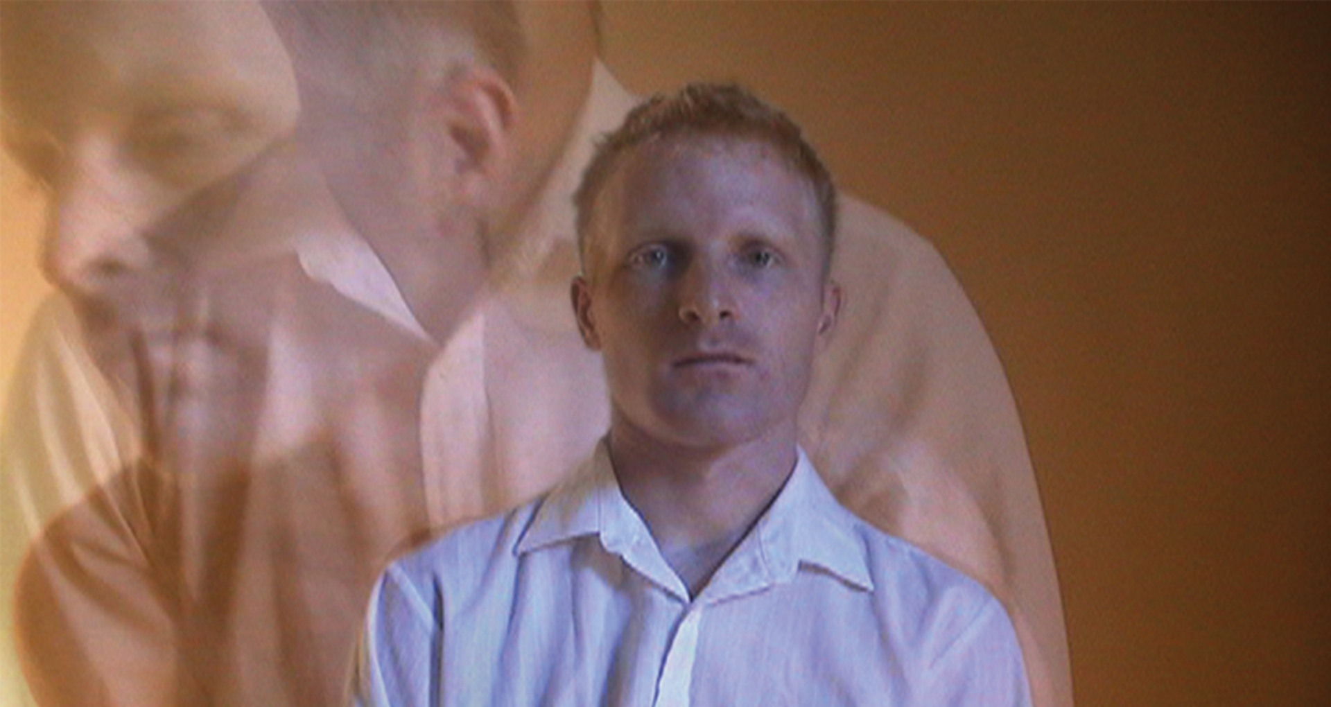 Color portrait of a blond man in white shirt. Overlay transparent images