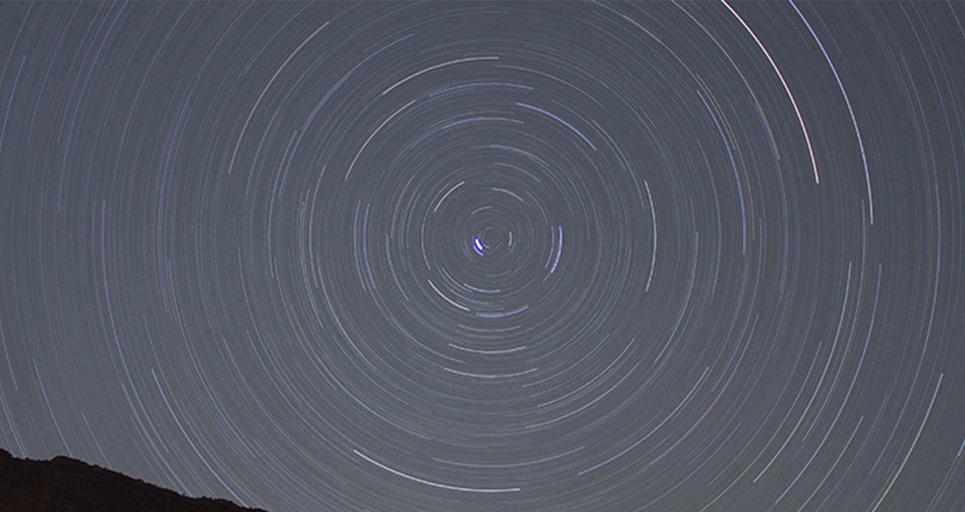 Color photo by night. Spirals in the sky